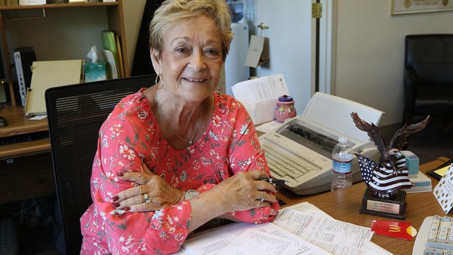 Marie O'Rourke has been at her desk in the Veterans' Services office in Billerica for 40 years. She is shown there Friday, Aug. 21, 2020.
