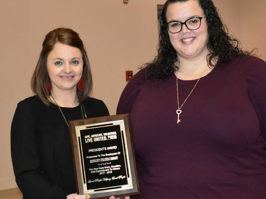 Kentucky Utilities' Erin French, right, receives the