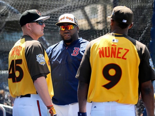 American League's David Ortiz, of the Boston Red Sox, center, talks with teammates Eduardo Nunez (9), of the Minnesota Twins, and and Trumbo, of the Baltimore Orioles, during batting practice at baseball's All-Star game, Tuesday, July 12, 2016, in San Diego. (AP Photo/Lenny Ignelzi)