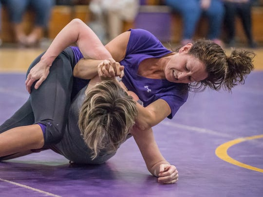 Bronson's Beth Barrows (top) wrestles Union City's