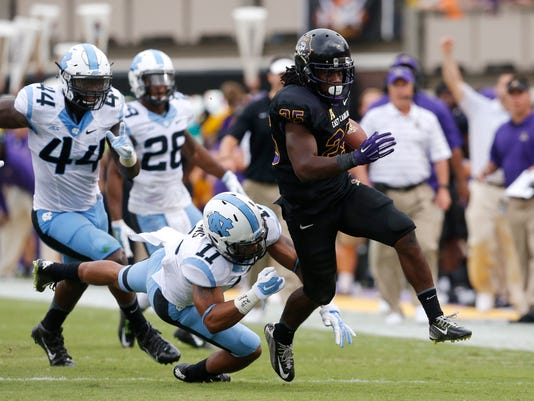 East Carolina running back Breon Allen (25) beats North Carolina's Malik Simmons while scoring a 44-yard touchdown during the first half of their NCAA college football game at Dowdy-Ficklen Stadium in Greenville, N.C., Saturday, Sept. 20, 2014. (AP Photo/The News & Observer, Ethan Hyman)