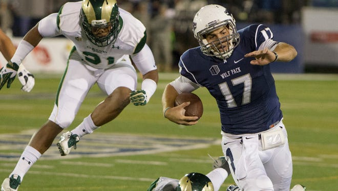 Nevada's Cody Fajardo runs from the Colorado State defense during their Mountain West game on Saturday at Mackay Stadium