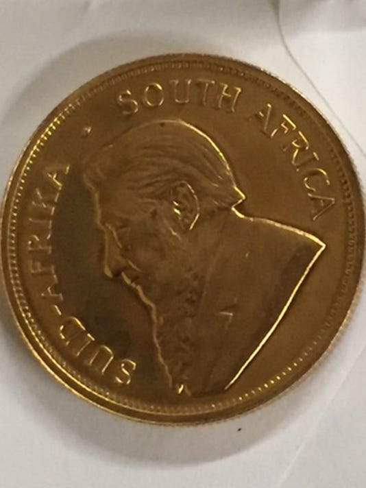 Donated gold coin front.jpg