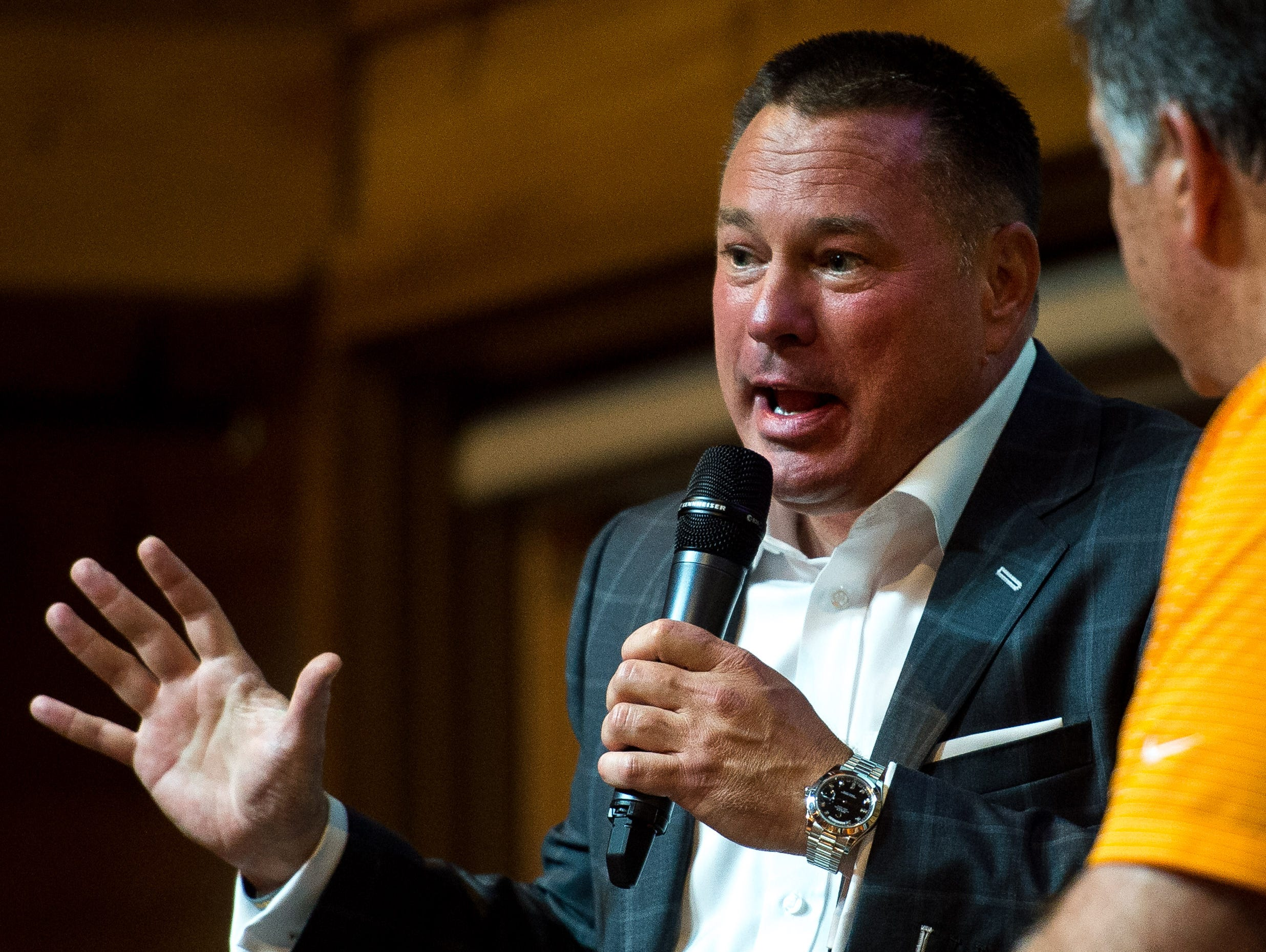"""Butch Jones, left, University of Tennessee football coach, speaks with """"The Voice of the Vols"""" Bob Kesling during a Big Orange Caravan event at The Barn at Sycamore Farms in Arrington, Tenn., Monday, July 10, 2017."""