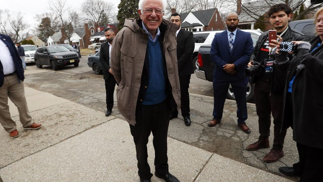 Democratic presidential candidate Sen. Bernie Sanders, I-Vt., visits outside a polling location at Warren E. Bow Elementary School in Detroit, Tuesday, March 10, 2020.