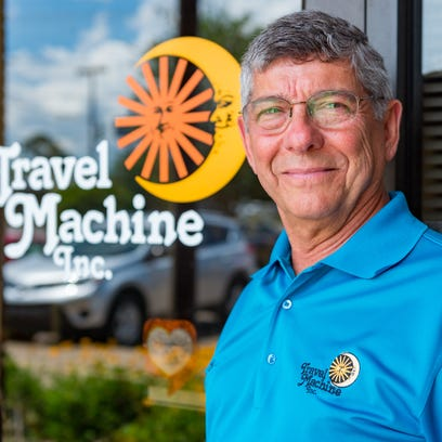 Kermit Duhon, owner of the Travel Machine travel agency,