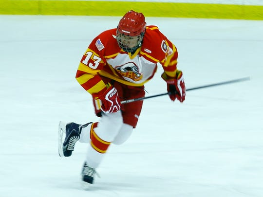 Ithaca forward Woocheol Kim skates up the ice Tuesday afternoon at the Rink in Lansing.