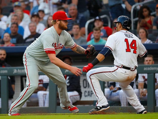 ATLANTA, GA - JUNE 08:  Ben Lively #49 of the Philadelphia Phillies tags out Rio Ruiz #14 of the Atlanta Braves in the second inning at SunTrust Park on June 8, 2017 in Atlanta, Georgia.  (Photo by Kevin C. Cox/Getty Images)