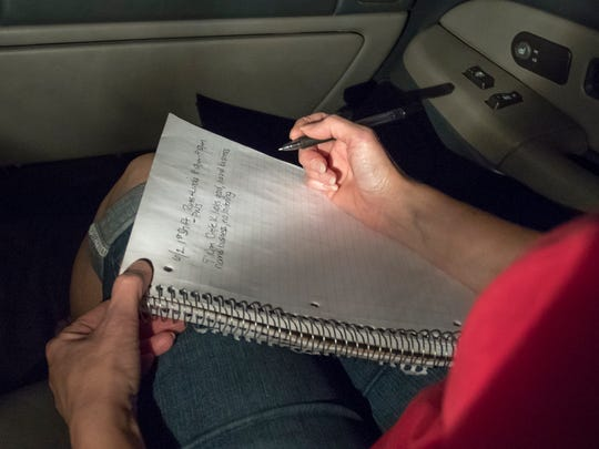 Diamond View Neighborhood Watch Group member Linda Warrick jots notes while on patrol in her Pensacola neighborhood on Friday, June 2, 2017.  The Diamond View Neighborhood Watch Group  regularly patrols to observe suspicious activities, make reports to law enforcement, and to help keep crime down.