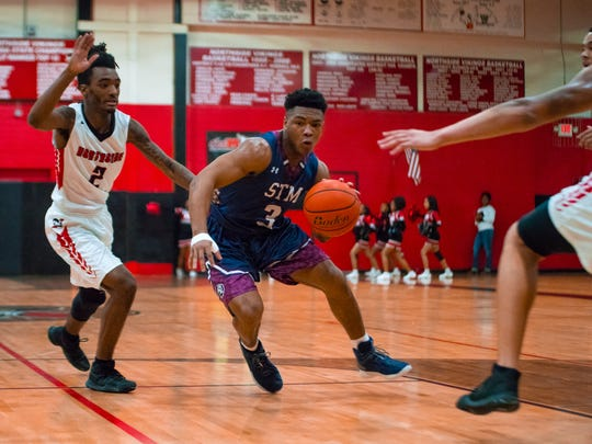 Jude Joseph works his way towards the goal as the Northside Vikings basketball team take on the St. Thomas More Cougars.
