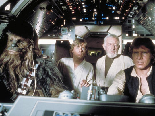 "Chewbacca (Peter Mayhew), Luke (Mark Hamill), Obi-Wan (Alec Guinness) and Han (Harrison Ford) in a scene from the motion picture ""Star Wars: Episode IV - A New Hope."""
