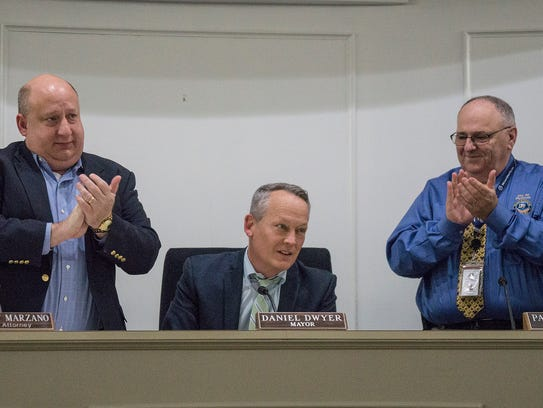 Mayor Dan Dwyer is returning to private life. He received a standing ovation from the audience as City Attorney Robert Marzano, City Manager Paul Sincock and the city commission honored him for his years of service to the community.
