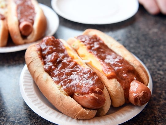 """Chef Kenny West says the hot dogs at the New Corral in Clifton are """"the best."""" This chili cheese hot dog is fried and smothered in sauce."""