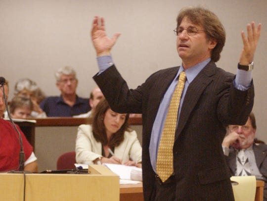 Court hearing. Barry Scheck, right, of the Innocence