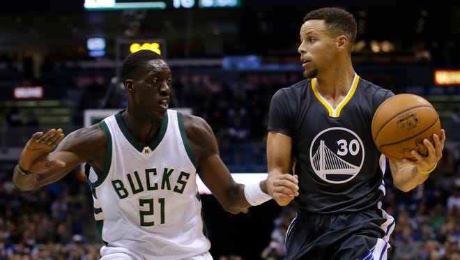 Tony Snell defends Golden State's Stephen Curry.