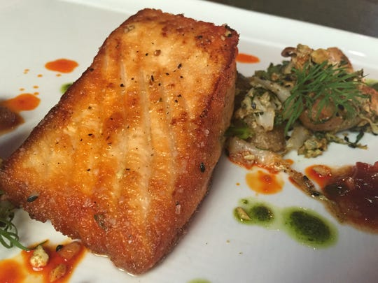 So much harmony floats between the salmon's lacy crust, tender interior and delicate curry flavors at Union 50.