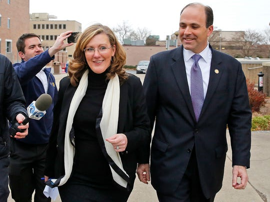 Republican incumbent state Del. David Yancey walks with campaign manager Gretchen Heal outside the Newport News Courthouse in Newport News, Va. A three judge panel on Wednesday, Jan., 3, 2018, has rejected a request to reconsider its ruling in an election recount between Yancey and Democrat challenger Shelly Simonds, that could determine partisan control of the Virginia House of Delegates. State elections officials plan to meet Thursday, Jan. 4, to randomly pick a winner in the contest.