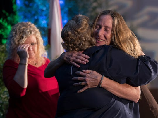 Courtney Fraser hugs Tamara Pigott, executive director for Lee County Visitor & Convention Bureau, after Fraser was named business tourism leader at the ninth annual Chrysalis Awards Thursday at Cape Coral's Westin resort.