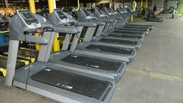 a row of treadmills at Absolute Fitness Solutions.