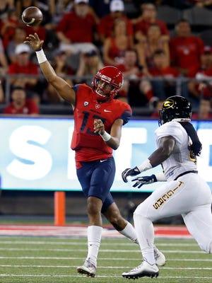 Arizona quarterback Brandon Dawkins (13) throws during the first half against Grambling State, Saturday, Sept. 10, 2016, in Tucson, Ariz.