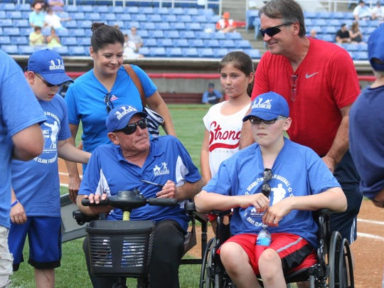 Brothers Ryan, left, and Zachary Strom, second from right, and their family speak with Dave Clark, third from left, during Disability, Dream & Do (D3) weekend.