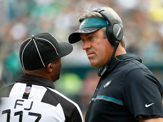 Philadelphia Eagles coach Doug Pederson talks with field judge John Jenkins during a game against the Cleveland Browns at Lincoln Financial Field.