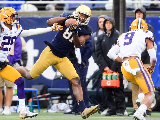 Notre Dame Fighting Irish wide receiver Miles Boykin (81) makes a catch in front of LSU Tigers cornerback Andraez Williams (29) during the second half in the 2018 Citrus Bowl at Camping World Stadium.