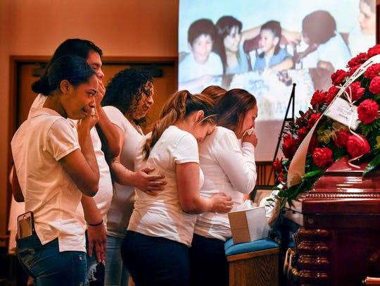 The cousins of Joe Rene Perez Jr. say goodbye during