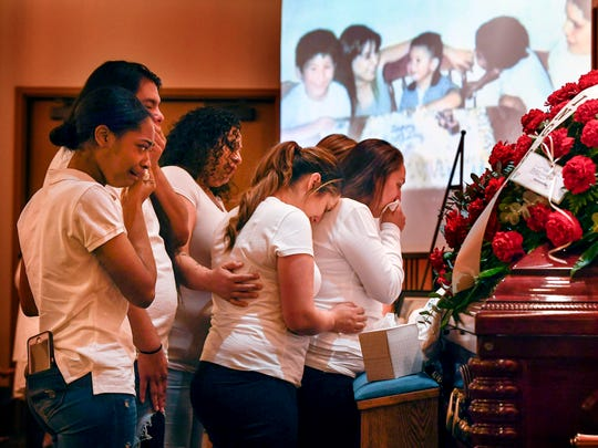 The cousins of Joe Rene Perez Jr. say goodbye during his visitation Monday, April 30, 2018, at Harrell Funeral Home in Kyle, Texas.