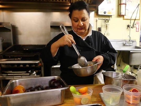 Movable Feast Executive Chef Lisa Scolaro prepares