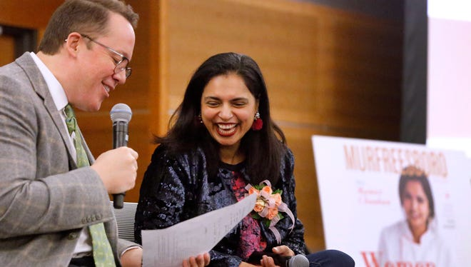 Nashville Lifestyle Magazine General Manager Brian Barry interviews Maneet Chauhan at Murfreesboro Magazine's annual Women business luncheon, held Tuesday at MTSU's Student Union Building.