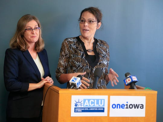 ACLU of Iowa Legal Director Rita Bettis, left, joins Carol Ann Beal, one of two transgender women suing Iowa over its ban on Medicaid coverage for transition-related medical services, during a news conference Thursday, Sept. 21, 2017, in Des Moines.
