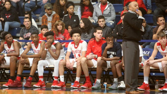 Coach Keith Wright, his Hamilton players and fans watch