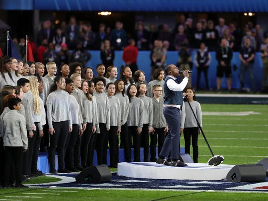 "Leslie Odom Jr. sings ""America the Beautiful"" prior Super Bowl LII between the New England Patriots and the Philadelphia Eagles at U.S. Bank Stadium in Minneapolis on Feb. 4, 2018."