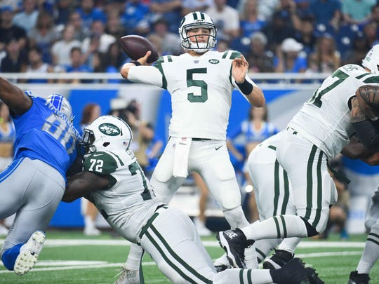 Aug 19, 2017; Detroit, MI, USA; New York Jets quarterback Christian Hackenberg (5) drops back to pass during the first quarter against the Detroit Lions at Ford Field. Mandatory Credit: Tim Fuller-USA TODAY Sports