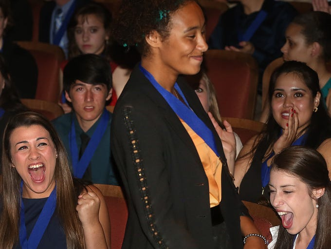 Mina Kaji (left) and Sarah Schrader-Nahoom cheer loudly as Leon High's Mackenzie Teek rises to get the top award on Wednesday. Leon County's top students were honored in 15 different categories during the 9th annual Best and Brightest Awards ceremony inside Ruby Diamond Auditorium on Wednesday, May 14, 2014.  The winner of the Spirit Award of the Best and Brightest, and the winner of an extra $2500 Scholarship was Mackenzie Teek from Leon High School.