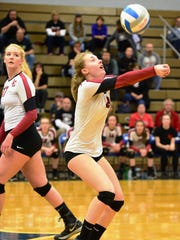 Churchill's Megan Gendjar (right) saves the ball in front of teammate Annie Yost.