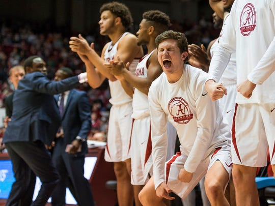 Lawson Schaffer, center, squatting, and others on the Alabama bench react to a shot by Alabama guard Herbert Jones (10) that drew a foul during the second half on Wednesday, Jan. 17, 2018, in Tuscaloosa. Alabama won, 76-71.
