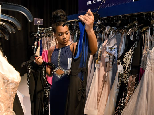 Fulton student Indigo Stephens looks through prom dresses as TLC's Say Yes to the Prom gave away prom dresses and accessories to students from several local high schools  Thursday, March 29, 2018 at the Discovery headquarters in West Knoxville.