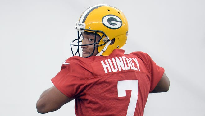 Green Bay Packers rookie Brett Hundley (7) drops back during rookie orientation in the Don Hutson Center May 8, 2015.