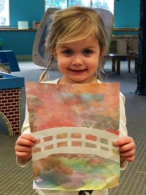 Sawyer Helton, 4, got a jump start on her Monet Garden watercolor at the Plainfield Public Library.