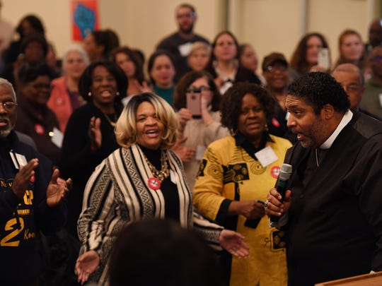 "The Rev. Dr. William Barber leading Friday night's workshop attendees in singing ""We Won't be Silent Anymore."""