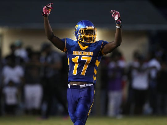 Rickards' Chris Pitts signals to his teammates on defense