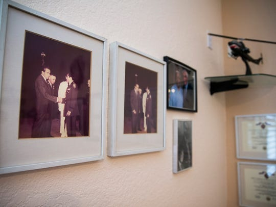 Photos of Vietnam War veteran Luis Chirichigno shaking hands with President Richard Nixon hang alongside his other service accolades and memorabilia at his home in North Naples.