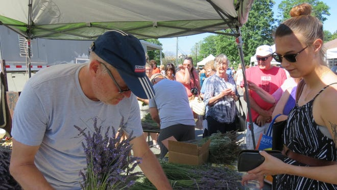 Joe Hollar from Smoky Mountain Lavender gets some lavender together for customers at the 2016 Lavender Festival.