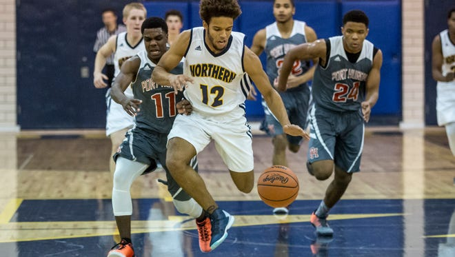 Port Huron Northern's Michael Burrell breaks away with the ball during a basketball game Friday, Dec. 16, 2016 at Port Huron Northern High School.