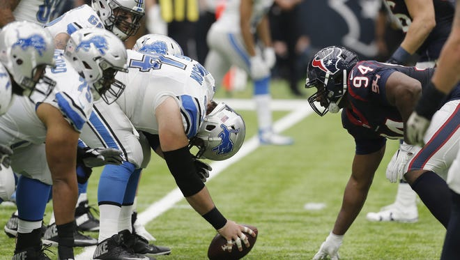 Lions center Travis Swanson prepares to hike the ball as Antonio Smith of the Houston Texans lines up in the second quarter at NRG Stadium on Oct. 30, 2016 in Houston.