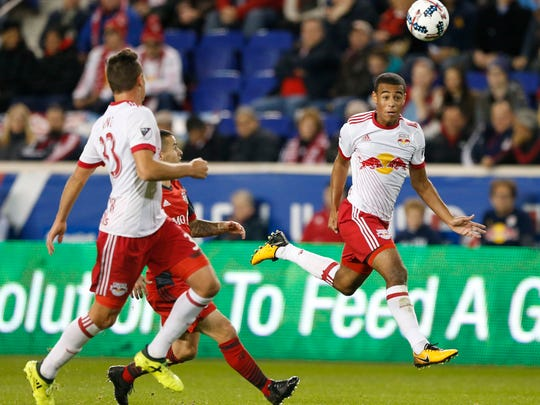 New York Red Bulls midfielder Tyler Adams, right, heads the ball away from Toronto FC forward Sebastian Giovinco in an Eastern Conference semifinal at Red Bull Arena on Oct. 30, 2017.