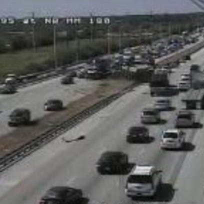 A tractor trailer on its side is causing traffic issues