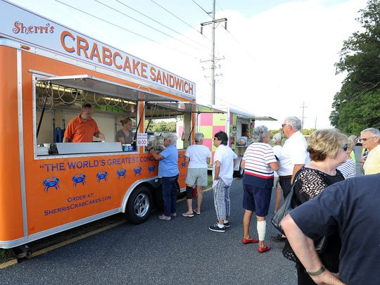 A long line forms for Sherri's Crab Cakes during the inaugural Food Truck Friday event in Rehoboth.